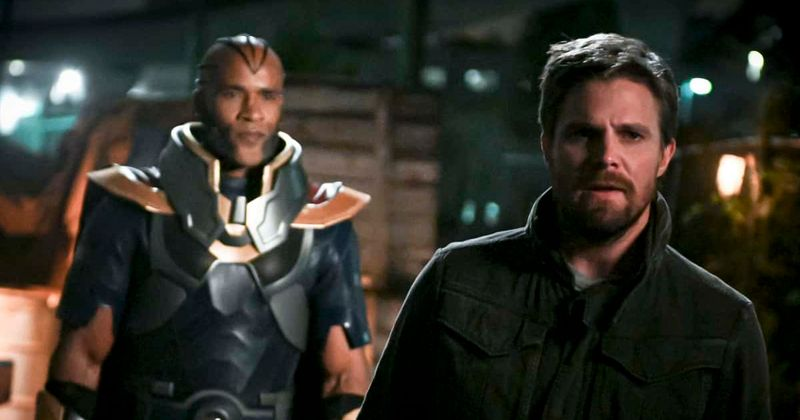 The monitor and Oliver Queen